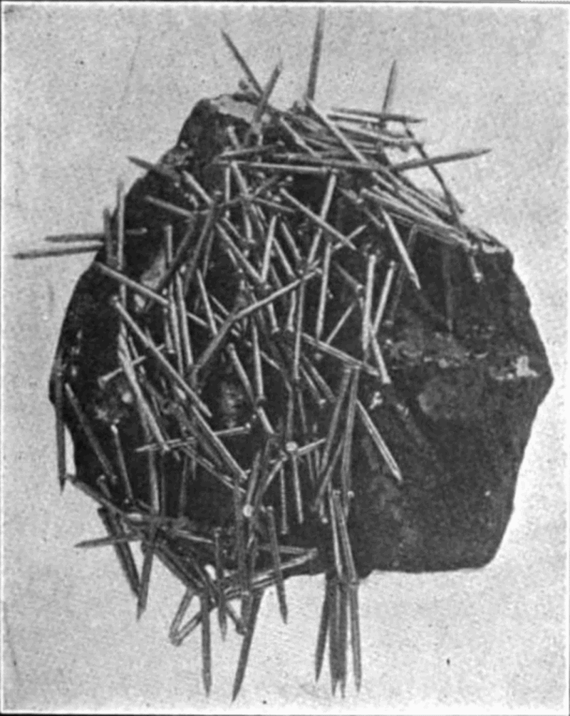 Public domain image of a [lodestone attracting nails](https://commons.wikimedia.org/wiki/File:Lodestone_attracting_nails.png)